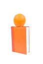 Orange on the diary big bright cover Royalty Free Stock Photo