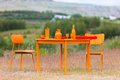Orange dining table and chairs at a field Stock Photography