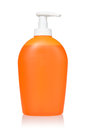 Orange dispenser with detergent isolated on white background Royalty Free Stock Image