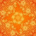 Orange doodle flowers ornate seamless pattern Stock Photos