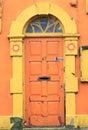 Orange door broken old ruin frame built structure doorframe front old colors yellow run down color image mail slot Stock Photos