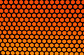 Orange dots on black Stock Images