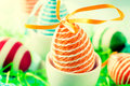 Orange easter egg in the cup selective focus on the Royalty Free Stock Photo