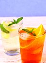 Orange, elderflower cocktails on blue background Royalty Free Stock Photo