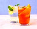 Orange and elderflower cocktails on blue background Royalty Free Stock Photo