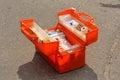 Orange emergency medical pack open in the asphalt road Royalty Free Stock Photo