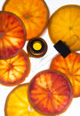 Orange essential oil in amber bottle with red oranges Royalty Free Stock Photo
