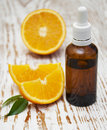 Orange essential oil with fresh fruits beauty treatment Stock Photography