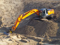 Orange excavator Royalty Free Stock Image