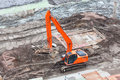 Orange excavator on a construction site standing Stock Photography