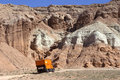 Orange expedition rv custom vehicle driving in remote san rafael swell utah Royalty Free Stock Image