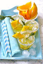 Orange fizz in a glass on turquoise background Stock Images