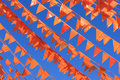 Orange flags against a blue sky during the soccer world cup also used on king day in holland Royalty Free Stock Photos