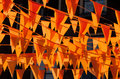 Orange flags against a blue sky during the soccer world cup also used on king day in holland Royalty Free Stock Photo