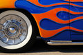 Orange flames on a blue roaster Royalty Free Stock Images