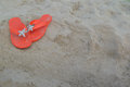 Orange flip flops on a beach Royalty Free Stock Photo