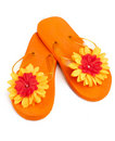 Orange flip-flops with flowers Royalty Free Stock Photo