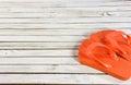 Orange flip-flops on whitewashed wood Royalty Free Stock Photo