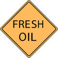Orange Fresh Oil road sign Stock Photos