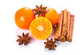 Orange fruit cinnamon sticks and anise stars isolated on white Stock Image