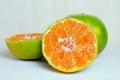 Orange fruit with half view on wood background other names are les oranger sweet citrus sinensis citrus aurantium citrus maxima Stock Images