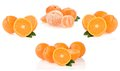 Orange fruit and slices on white Royalty Free Stock Image