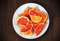 Orange fruit in two colors cut in pieces as healthy snack of red and Stock Photography