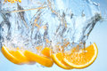Orange fruit under water with splash Stock Photo