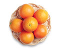 Orange fruit in wooden wicker plate on white background top view Royalty Free Stock Photography