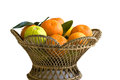 Orange fruits in basket isolated on white Stock Image