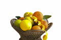 Orange fruits in basket isolated on white Royalty Free Stock Image