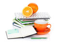 Orange fruits coffee cup and office supplies isolated on white background Royalty Free Stock Photo