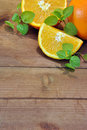 Orange fruits cut pieces of on a wooden table Stock Images