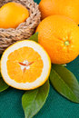 Orange fruits over green canvas fabric fresh Stock Photos