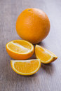 Orange fruits on the table against dark oak Royalty Free Stock Photos