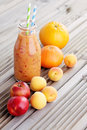 Orange fruity smoothie bottle of food and drink Stock Photos