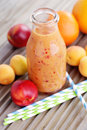 Orange fruity smoothie bottle of food and drink Royalty Free Stock Photography
