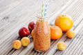 Orange fruity smoothie bottle of food and drink Royalty Free Stock Images