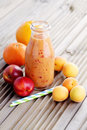 Orange fruity smoothie bottle of food and drink Royalty Free Stock Image