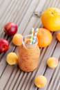 Orange fruity smoothie bottle of food and drink Stock Photography