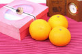 Orange and gift box on red background Royalty Free Stock Photography