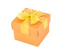 Orange gift box with yellow ribbon isolated om white background Royalty Free Stock Images