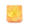 Orange gift box with yellow ribbon isolated om white background Stock Photography