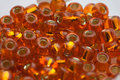 Orange glass beads toho shiny seed Stock Photography