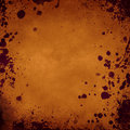 Orange grunge background with splatters in the borders frame Stock Photography