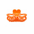 Orange hair clip isolated on white background Royalty Free Stock Photography