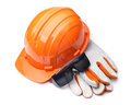 Orange hard hat and leather gloves Royalty Free Stock Photo