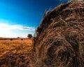 Orange hayrick haystack background Stock Photo