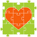 The orange heart collected from puzzles Stock Photography