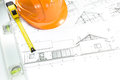 Orange helmet and project drawings Royalty Free Stock Photo